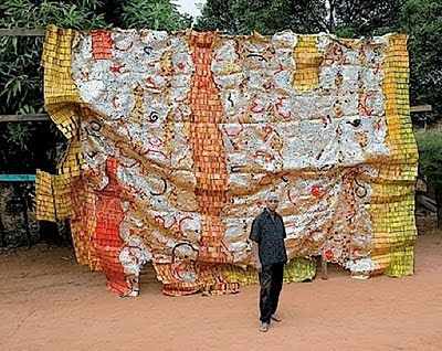El Anatsui draped wall installation.